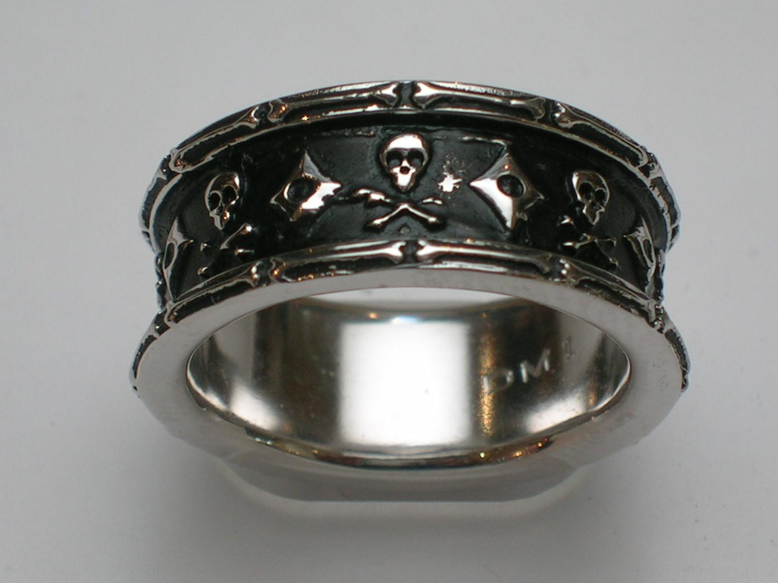 Black Antiqued Skull And Crossbones Ring In Gold Diana Michaels