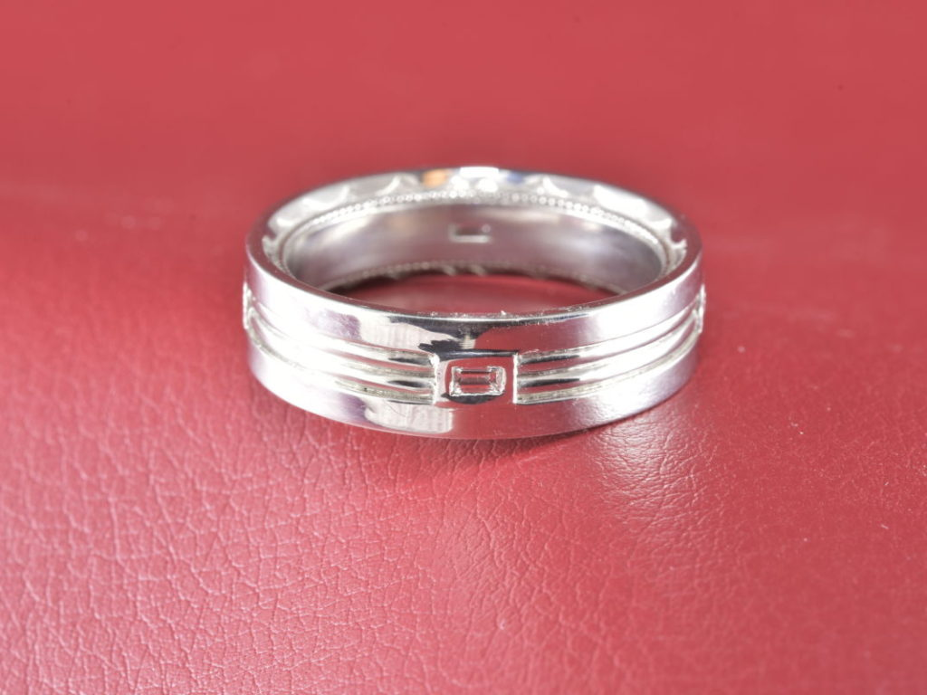 Platinum Ribbed Ring Accented by Baguettes - Diana Michaels Jewelers